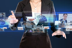 Business woman in hightech concept. Business women in hightech concept. Conceptual image hand touching to virtual screen stock images