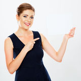 Business woman hold banner, finger pointing, white background. Portrait. Female business model. Smiling girl isolated royalty free stock photo