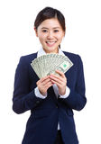 Business woman hold cash Royalty Free Stock Photography