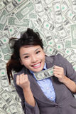 Business woman hold fist with money Stock Photography