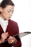 Business woman hold a folder of papers and write Stock Image