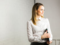 Business woman hold a folder Royalty Free Stock Photography