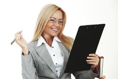 Business woman hold a folder and write Stock Images