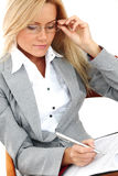 Business woman hold a folder and write Royalty Free Stock Photos