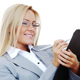 Business woman hold a folder and write Stock Photos