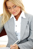 Business woman hold a folder and write Stock Photo