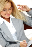 Business woman hold a folder and write Royalty Free Stock Image