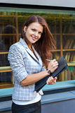 Business woman hold a folder and write Stock Photography