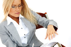 Business woman hold a folder and write Royalty Free Stock Photography