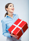 Business woman hold gift box in christmas color style, studio p Stock Images