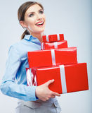 Business woman hold gift box in christmas color style, studio p Royalty Free Stock Images
