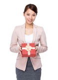 Business woman hold with gift box. Isolated on white background Stock Photos