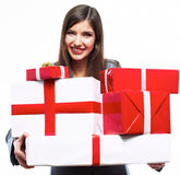 Business woman hold gift box. White background iso. Lated female model Stock Photography