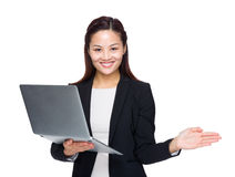 Business woman hold laptop computer and open hand palm Royalty Free Stock Photography