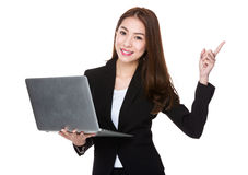 Business woman hold laptop and finger point up Royalty Free Stock Photography