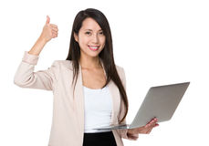 Business woman hold with laptop and thumb up Stock Image