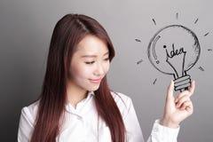 Business woman hold light bulb Stock Photos