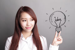 Business woman hold light bulb Royalty Free Stock Photography