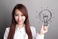 Business woman hold light bulb Royalty Free Stock Photo