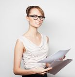 Business woman hold pages of paper Royalty Free Stock Image