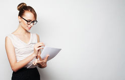 Business woman hold pages of paper Royalty Free Stock Photography