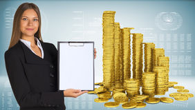 Business woman hold paper holder and pyramid from. Business woman hold paper holder. Pyramid from gold coins as backdrop Royalty Free Stock Photos