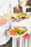Business woman hold plate with catering food royalty free stock photography