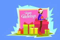 Business Woman Hold Present Box Messaging Online Cell Phone Merry Christmas And Happy New Year. Flat Vector Illustration Royalty Free Stock Photo