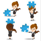 Business woman hold puzzle Royalty Free Stock Photography