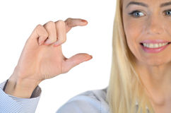 Business woman hold something in fingers. Isolated business woman hold something in fingers Stock Images