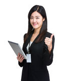 Business woman hold tablet and thumb up Stock Photo