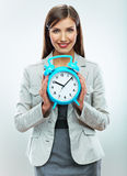 Business woman hold watch. Time concept. Smiling girl portrait, Stock Photos