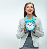 Business woman hold watch. Time concept. Smiling girl portrait, Stock Images