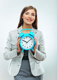 Business woman hold watch. Time concept. Smiling g Stock Photo