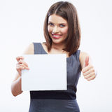 Business woman hold white blank paper. Young smiling girl show Royalty Free Stock Photos