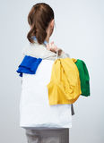 Business woman hold white shopping bag turned back. Royalty Free Stock Photo