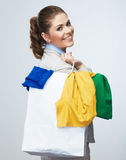 Business woman hold white shopping bag turned back. Stock Photo