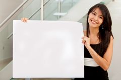 Business woman holding ad Stock Image