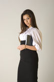 Business woman holding agenda. Beautiful girl in business outfit with blue agenda royalty free stock image