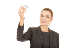 Business woman holding airplane model. Royalty Free Stock Photography