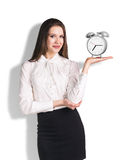 Business woman holding the alarm clock Stock Photo