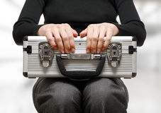 Business woman holding an aluminium briefcase Stock Photography