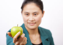 Business woman holding an apple. Stock Image
