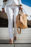 Business woman holding a bag Royalty Free Stock Image