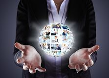 Business woman holding a ball of people Stock Photo