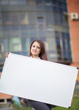 Business woman holding banner. Ad in her office Stock Photos