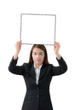 Business woman holding a banner isolated Stock Photography
