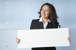 Business woman holding a banner. Business woman holding a white banner Royalty Free Stock Photo