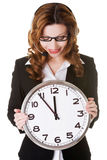 Business woman holding big clock. Stock Images