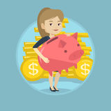 Business woman holding big piggy bank. Stock Photos